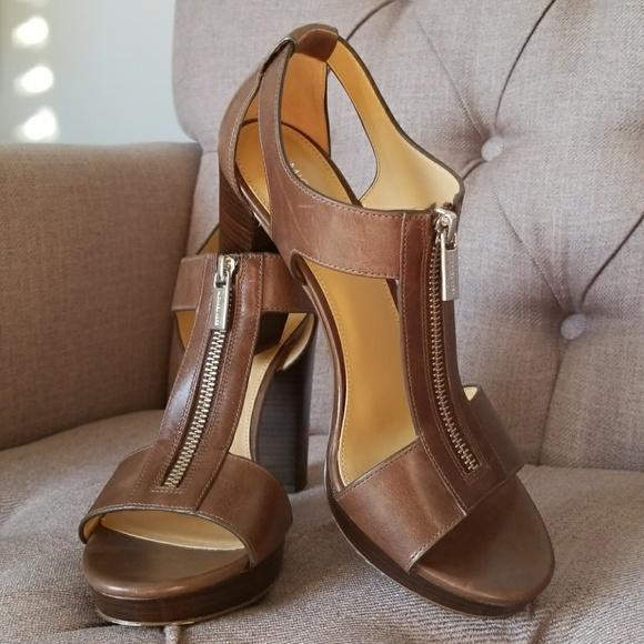 576ed63bbc9a Michael Kors Berkley Lock T-Strap High Heel Sandal.  M 5a5a8c1a3a112efc73903583